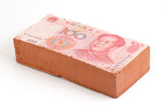 Brick with a Chinese Yuan. Bank note imprint Royalty Free Stock Photos