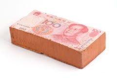 Brick with a Chinese Yuan. Bank note imprint Royalty Free Stock Photos