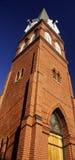 Brick Church. A brick church and steeple against a blue sky Stock Photos