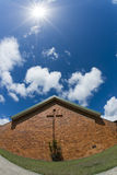 Brick Church with Bright Sun Above Royalty Free Stock Photo