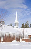 Brick Church covered with Snow and Icicles Royalty Free Stock Photos