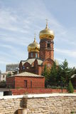 Brick church with gilded dome Royalty Free Stock Image