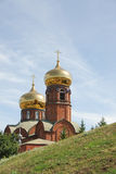 Brick church with gilded dome Stock Photos
