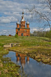 A brick Church on the water in Russia Stock Photos