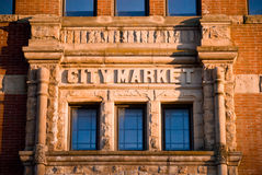 Brick City Market Building. A brick building with city market above the windows Stock Image