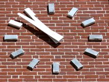 Brick Clock. Clock face on an old brick tower royalty free stock images