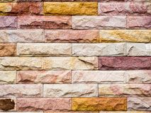 Brick colorful horizontal architecture wallpaper. Brick blocks of stonework colorful horizontal architecture wallpaper royalty free stock image