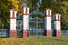 The brick columns which are propping up metal gate Royalty Free Stock Image