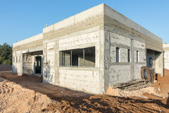 Brick and concrete house under construction Stock Photography