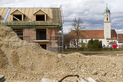 Brick construction site and church, Germany Royalty Free Stock Image