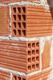 Brick corner edge red construction clay bricks. Hollow airbrick Royalty Free Stock Images