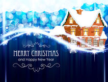 Brick cottage  on a blue Christmas background Stock Image