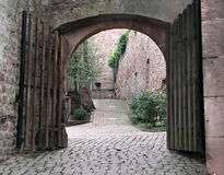 Brick courtyard arch. View through arch of brick courtyard Royalty Free Stock Photography