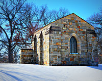 Brick Crypt in Snow Covered Cemetery Royalty Free Stock Image