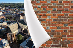 Brick cuff on the beautiful panorama of Lvov city Royalty Free Stock Image