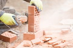 Free Brick Cutting With Angle Grinder Tool Stock Photos - 142976313