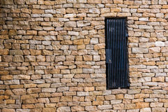 Brick door with black door. Background & texture Stock Photo