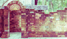 The brick door and wall, vintage toning Royalty Free Stock Images