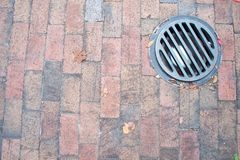 Brick with Drain. Brick walkway with recessed light Royalty Free Stock Images