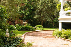 Brick Driveway Past Landscaped Garden Stock Photography