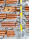 Brick and electric pipes Stock Photography