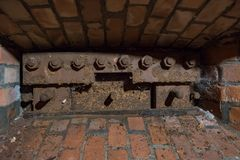 Brick embrasure with metal protection. View of a brick embrasure with metal protection royalty free stock image