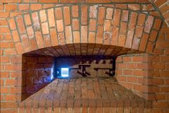 Brick embrasure with opened metal protection. View of a brick embrasure with opened metal protection stock images