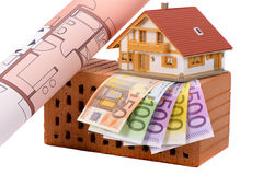 Brick and euro money with model house. Brick for house construction and Euro money Stock Photography