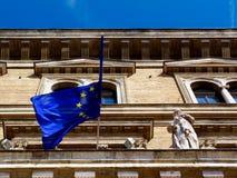 Exterior facade with EU flag half folded under blue sky royalty free stock photography