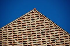 Brick facade against blue sky Royalty Free Stock Images