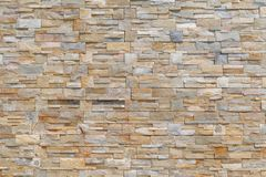 Brick facade as background image. Grey brown brick facade as background image. Full frame architectural detail stock photography