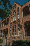 Brick facade of building and Doctor Thomas Montanus bust at City Center of Bruges. With many canals and old buildings, this graceful town is a World Heritage Royalty Free Stock Images