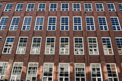 Brick facade with large windows Royalty Free Stock Images