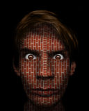 Brick Face. A man with a serious fierce stare on his face with made out of hard brick Royalty Free Stock Photography