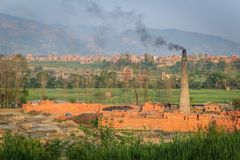 Brick factory with chimney and black smoke Stock Photo
