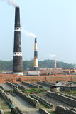 Brick factory overview. Brick factory in Bangladesh with its smoking chimneys Stock Photo