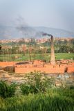 Brick factory with tall chimney. Brick factory in Nepal. Taken outside Bhaktapur. Portrait photo Stock Photography
