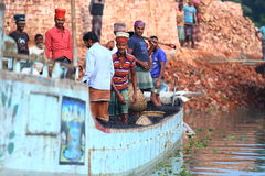 Brick factory workers in boat. Hard working young man at a brick factory in Bangladesh loading their boat with bricks Stock Photography