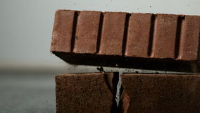 Brick falling on and breaking another stock video footage