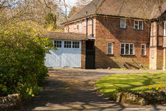 Brick family house. Old brick family house with car garage Royalty Free Stock Images