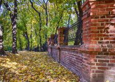 Brick fence. The red brick fence in the forest Royalty Free Stock Photography