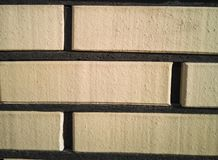 Brick fence with well-defined seams. Texture, background royalty free stock photos