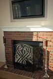 Brick fireplace and flat-screen TV Royalty Free Stock Photo