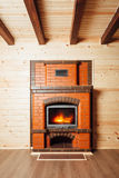 Brick fireplace in wooden house Stock Photo