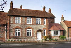 Brick and Flint House. On a Village Street in England Stock Photos
