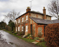 Brick and Flint House. Winter scene of a Brick and Flint House on a Country Lane in Rural England Stock Photos