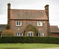 Brick and Flint House. On a Village Green in England Stock Photos