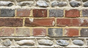 Brick and flintstone wall Stock Images