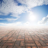 Brick floor and Clouds sky for background Royalty Free Stock Photo