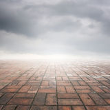 Brick floor and rainclouds for background Stock Images